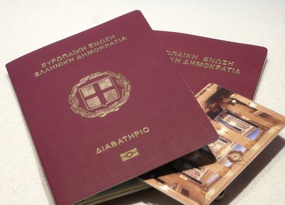 Greek passports, travel documents and a hotel's key